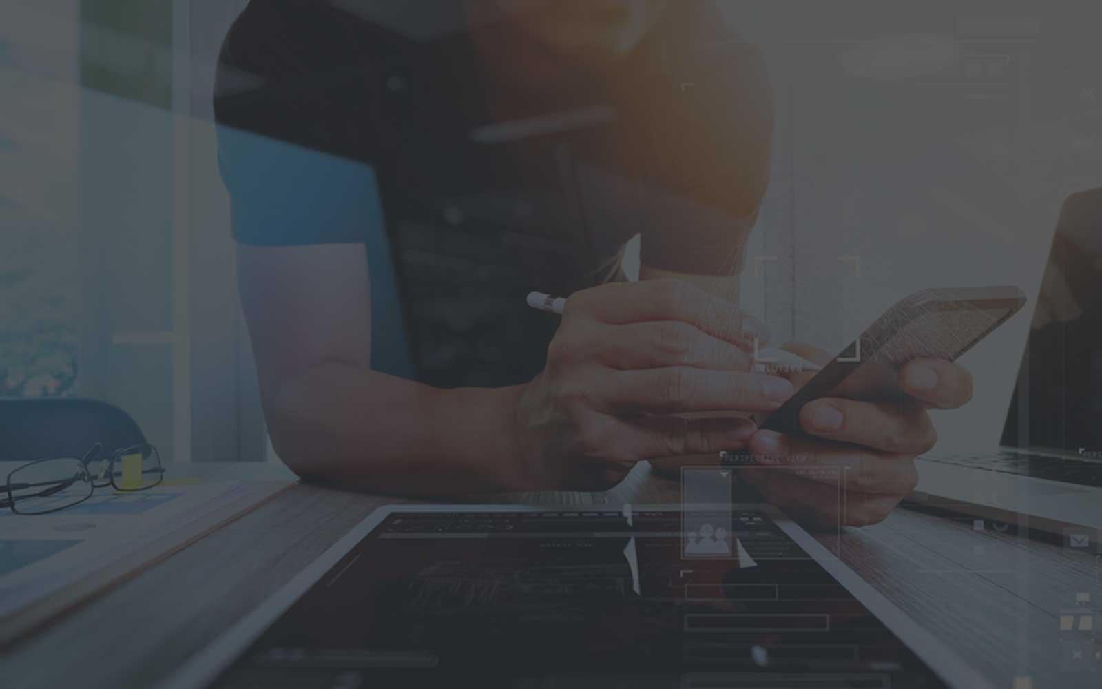 website designer working on responsive design for tablet, laptop, and phone